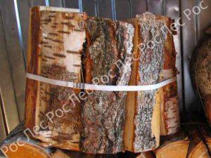 Дрова в сетках и вязанках